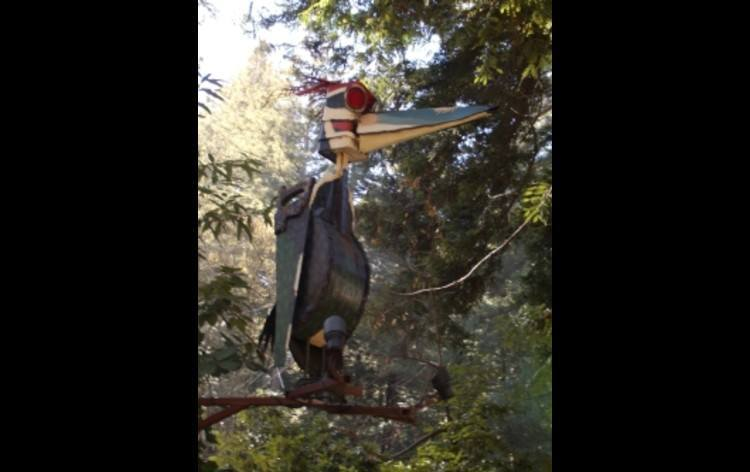 The Patrick Amiot sculpture of the property mascot, the Pileated Woodpecker