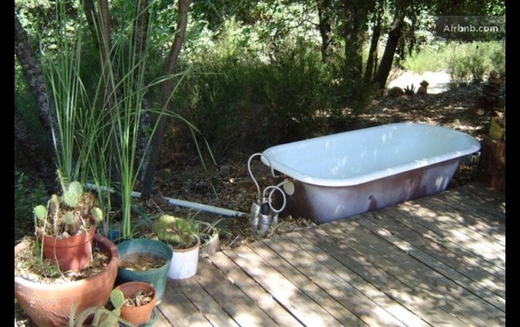Outdoor claw foot bathtub...  (Pure heaven, and yes--the water is hot.)